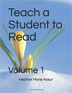 "The words ""TeThe words ""Teach a Student to Read"" and ""Volume 1"" and ""Heather Marie Kosur"" in black writing on a sky blue background with white snow at the bottom and a yellow crocus with green leaves in the lower left corner.ach a Student to Read"" and ""Volume 1"" and ""Heather Marie Kosur"" in black writing on a sky blue background with a yellow crocus with green leaves in the lower right corner."